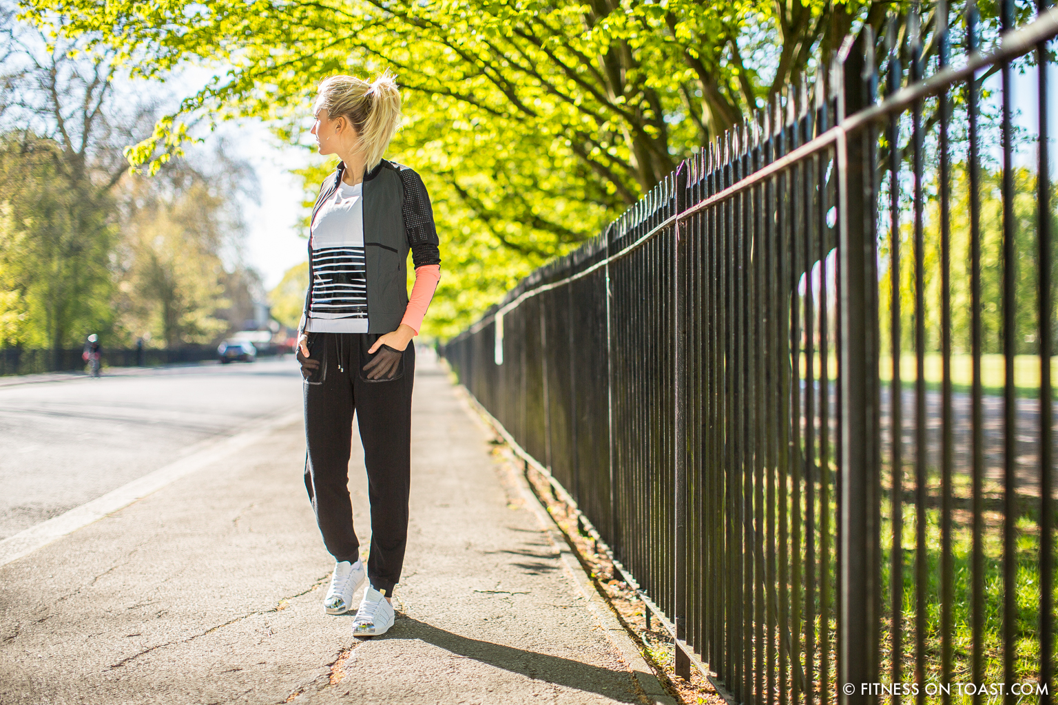 Faya Nilsson of Fitness On Toast in collaboration with Selfridges for 'The Body Studio'; Wearing Monreal top and slouchy bottoms, with Adidas shoes and t-shirt by the running track in Regent's Park in London